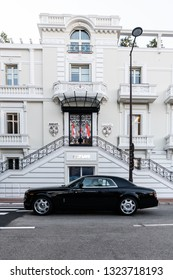 Monte-Carlo, Monaco 26 February 2019, Rolls Royce Phantom coupe driving pass Classic architecture bank Barclays with Monaco flags