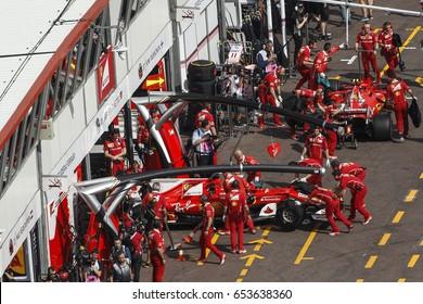 Montecarlo, Monaco. 28 May 2017. F1 Monaco Grand Prix. Ferrari cars of Vettel and Raikkonen, in pit lane.