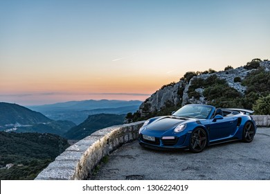 Monte-Carlo, Monaco 6 February 2019, Porsche 911 Turbo S Cabriolet blue open roof, sunset mood in mountain