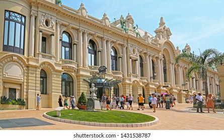Monte-Carlo, Monaco - June 13, 2014: people passing in the square near the opera house and casino