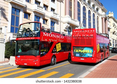 Monte-Carlo, Monaco - March 12, 2019: Red sightseeing buses Ayats Bravo I in the city street.