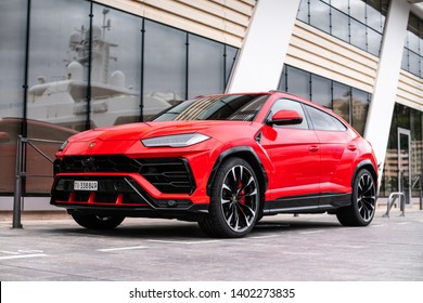 Monte-Carlo, Monaco - May 20 2019: Red Lamborghini Urus super SUV in port parking slot. This is the first SUV by the Italian supercar brand. Front and side view.