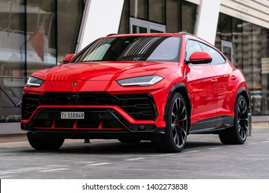 Monte-Carlo, Monaco - May 20 2019: Red Lamborghini Urus super SUV in port parking slot. This is the first SUV by the Italian supercar brand. Lights on.