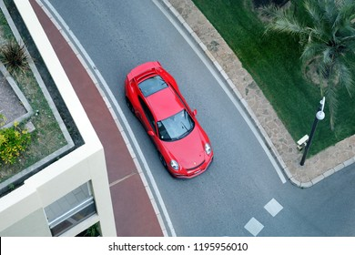 Monte-Carlo, Monaco - October 5 2018 : Aerial View Of A Beautiful Red Porsche 911 GT3 (Top View) Driving On The Boulevard Du Larvotto In Monaco, French Riviera