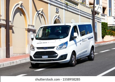 Monte-Carlo, Monaco - September 12, 2019: White passenger bus Ford Transit in the city street.