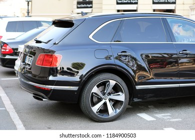 Monte-Carlo, Monaco - September 19 2018 : Luxury Black SUV Bentley Bentayga (Side View) Parked in Front of the Monte-Carlo Casino in Monaco, French Riviera