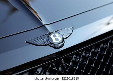 "Monte-Carlo, Monaco - September 19 2018: Shining Bentley Winged ""B"" Logo (Emblem) On The Bonnet Of A Luxury Black Car At Monte-Carlo, Monaco. Closeup View"