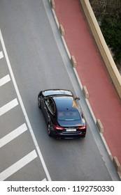 Monte-Carlo, Monaco - September 30 2018 : Aerial View Of A Beautiful Black Maserati Quattroporte 3.0 Diesel V6 2017 (Top View) Driving On The Boulevard Du Larvotto In Monaco, French Riviera