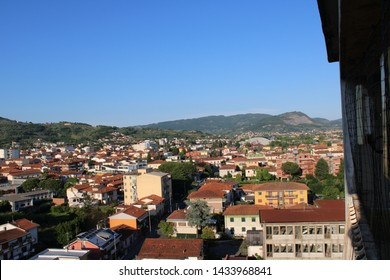 "Montecatini Terme - Italy / June 2, 2019. Different views of Montecatini Terme taken from the bell tower of the church ""Corpus Domini"". Here a view on Monsummano and the sport tent ""Palaterme""."