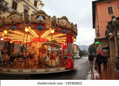 MONTECATINI-TERME, ITALY - JANUARY 8, 2016: Vintage carousel on the street in rainy winter day, Montecatini Terme, Italy.