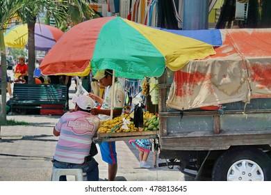 MONTECRISTI, ECUADOR - CIRCA AUGUST 2016: Vendor on the main street