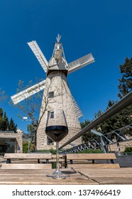 Montefiore windmill, Jerusalem. View from a coffee shop. Montefiore windmill is a famous municipal museum and beautiful public domain in Israel