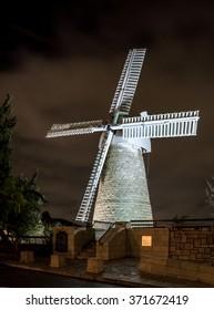 Montefiore Windmill at night illuminated by electric light, Jerusalem, Israel