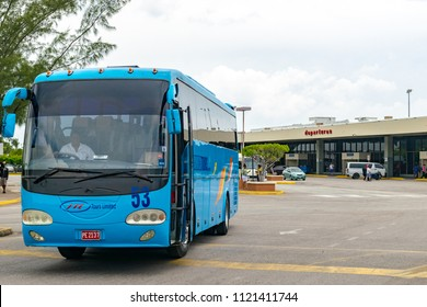 Montego Bay, Jamaica - June 06 2015: Tour Bus at the Sangster International Airport in Montego Bay, Jamaica.