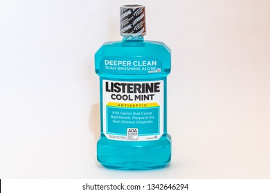 Montego Bay, Jamaica - March 15 2019: Bottle of Listerine Cool Mint Mouthwash isolated on white background