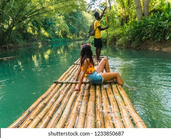 Montego Bay/Jamaica - July 2019: Woman looking out whilst sitting and relaxing on bamboo raft, whilst on cruise on vacation in Caribbean.  Martha Brae