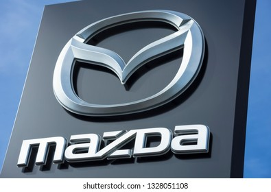 Montelimar, France: March/03/2019; Brand logo at the entrance to Mazda dealership in Montelimar, France - Mazda is a Japanese multinational car manufacturer.