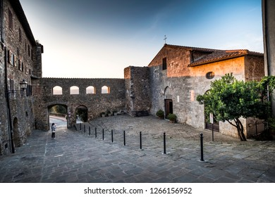 MONTEMERANO, GROSSETO, ITALY - JULY 29, 2018: - unknown woman, village in Maremma. The church of St. George, Montemerano is a 12th century town in the heart of Maremma, at 55 kilometers from Grosseto,