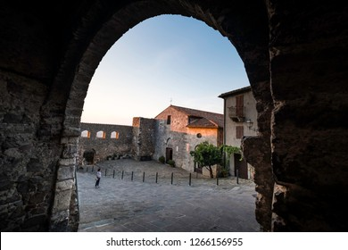 MONTEMERANO, GROSSETO, ITALY - JULY 29, 2018: - unknown woman,  village in Maremma. The church of St. George, Montemerano is a 12th century town in the heart of Maremma, at 55 kilometers from Grosseto