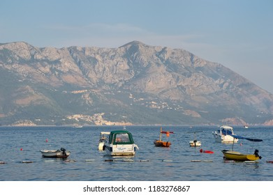 Montenegro, Budva - August 8, 2017: Boats anchored in the bay of city Budva against the background of mountains