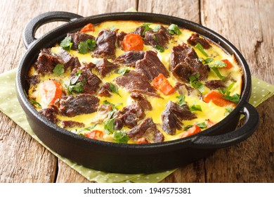 Montenegro dish Balsica tava veal with vegetables baked with eggs, sour cream and milk close-up in a pan on the table. horizontal