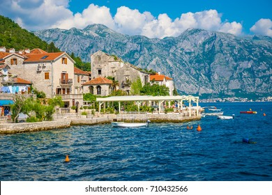MONTENEGRO - JUNE 04/2017. Tourists sailed on the yacht past the city of Perast in the Boka Bay of Kotor.