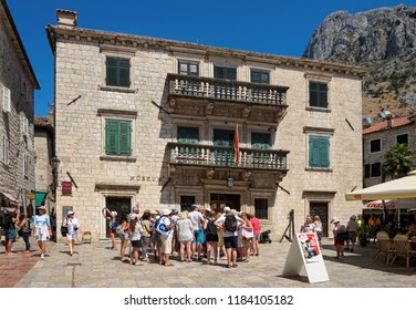 Montenegro, Kotor - August 13, 2017: Tourists near the Maritime Museum located in the Grgurina Palace, 1732, landmark