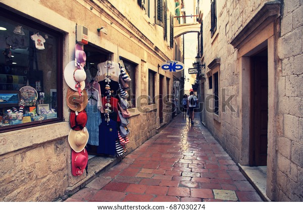 MONTENEGRO. KOTOR - JUNE 21, 2017: Showcase of a clothing store in the historic district of the city on a summer day. Kotor is a picturesque ancient city