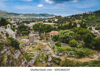 Montenegro landscape with cloudy mountains and ancient stone ruines of Old Bar town. Stari Bar - ruined medieval city on Adriatic coast, Unesco World Heritage Site.