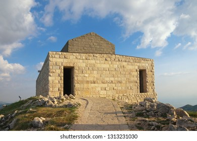 Montenegro, Lovcen National Park . View of Mausoleum of Petar II Petrovic Njegos on Jezerski Vrh peak