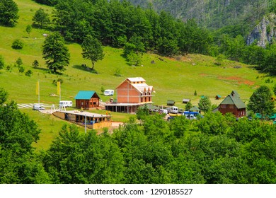 Montenegro mountains. A small wooden village in the high mountains covered with green forest. Canyon of the Tara and Moraca Rivers, Montenegro.