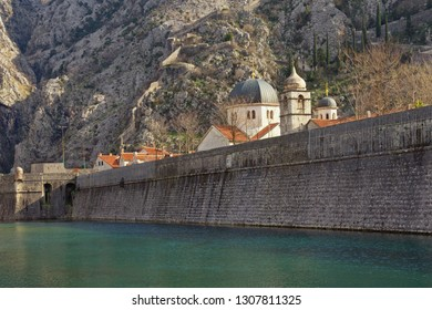 Montenegro, Old Town of Kotor - UNESCO World Heritage site.  View of northern walls and Skurda river on sunny winter day