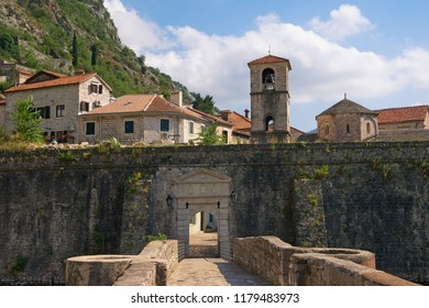 Montenegro . Old Town of Kotor, UNESCO-World Heritage Site. View of northern walls of ancient fortress, River Gate (also North Gate) and church of St. Mary