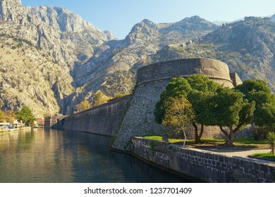 Montenegro.  Old Town of Kotor, UNESCO-World Heritage Site.  View of Skurda river, walls of ancient fortifications and Kampana Tower