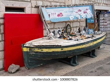 Montenegro, Perast - August 13, 2017: Souvenir shop in the form of a boat on the waterfront of the city of Perast