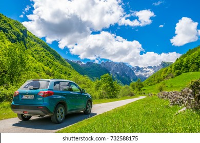 MONTENEGRO, PROKLETIJE MOUNTAINS - MAY 29/2017: tourists in Suzuki Vitara car went on a trip to the snow-capped mountains