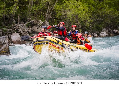 MONTENEGRO, RIVER TARA - April 30.2017. Rafting on a mountain river. Waves with spray and foam crashing on the side of the boat, and people rowing oars. Extreme sport.