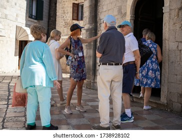 Montenegro, Sep 16, 2019: Group of tourists at St. Luke's Square in Kotor Old Town