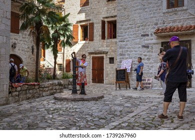 Montenegro, Sep 16, 2019:  Tourists taking photos at one of the squares in Kotor Old Town