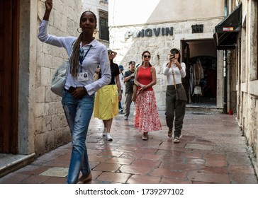 Montenegro, Sep 21, 2019: A group of tourists following the guide on the streets of Kotor Old Town