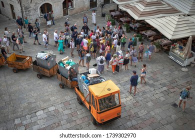 Montenegro, Sep 22, 2019: A large group of tourists follow the guide at the Saint Tryphon Plaza in Kotor Old Town