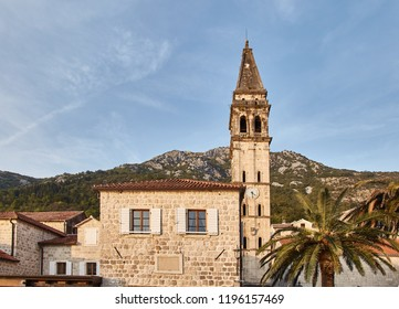 Montenegro. The Town Of Perast. Streets of old Perast. Summertime. Plant on building.