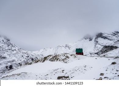 Montenegro, Winter snowscape and lonely alpine hut in snow covered durmitor national park mountains nature landscape in spring in may near zabljak