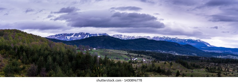 Montenegro, XXL landscape panorama of zabljak nature around durmitor mountains and white snow covered peaks surrounded by green forest