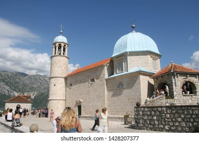 Montenegro/Perast  - September 6, 2010: Our Lady of the Rock island and Church in Perast on shore of Boka Kotor bay (Boka Kotorska), Montenegro, Europe. Kotor Bay is a UNESCO World Heritage Site.