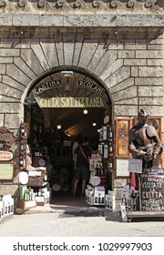 MONTEPULCIANO, ITALY - JULY 19, 2017: Entrance of traditional wine shop in Montepulciano, Val d'Orcia, Tuscany, Italy. The town is famous for its Vino Nobile, the most famous wine from Montepulciano.