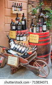 MONTEPULCIANO, ITALY - JULY 21: Bottles of Vino Nobile, the most famous wine from Montepulciano, on display outside a   winery, on July 21, 2017, in Montpulciano, Tuscany, Italy