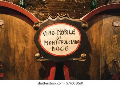 Montepulciano, Italy - November 1, 2016: Oak barrels in an old Italian wine cellar.
