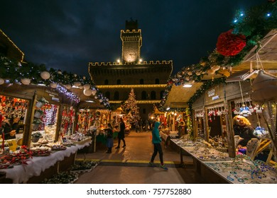MONTEPULCIANO, ITALY - NOVEMBER 18, 2017: Christmas market and tree at night in the historic center of Montepulciano medieval village, Tuscany
