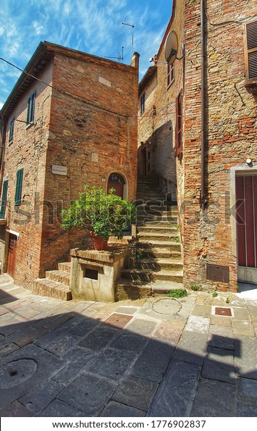 Montepulciano, Tuscany, Italy - July 15 2020: Beautiful view of an alley of Montepulciano, a tuscan town between val d' Orcia e val di Chiana in Italy.